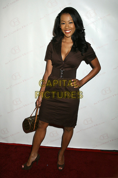 "DENYCE LAWTON .The 2nd Annual ""30 Under 30 Awards"" at The Camden House, Beverly Hills, California, USA..May 3rd, 2007.full length brown dress belt hand on hip louis vuitton bag purse .CAP/ADM/BP.©Byron Purvis/AdMedia/Capital Pictures"
