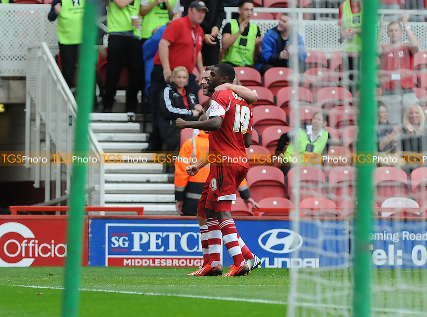 Mustapha Carayol of Middlesbrough celebrates scoring the equaliser - Middlesbrough vs AFC Bournemouth - Sky Bet Championship Football at the Riverside Stadium, Middlesbrough - 21/09/13 - MANDATORY CREDIT: Steven White/TGSPHOTO - Self billing applies where appropriate - 0845 094 6026 - contact@tgsphoto.co.uk - NO UNPAID USE