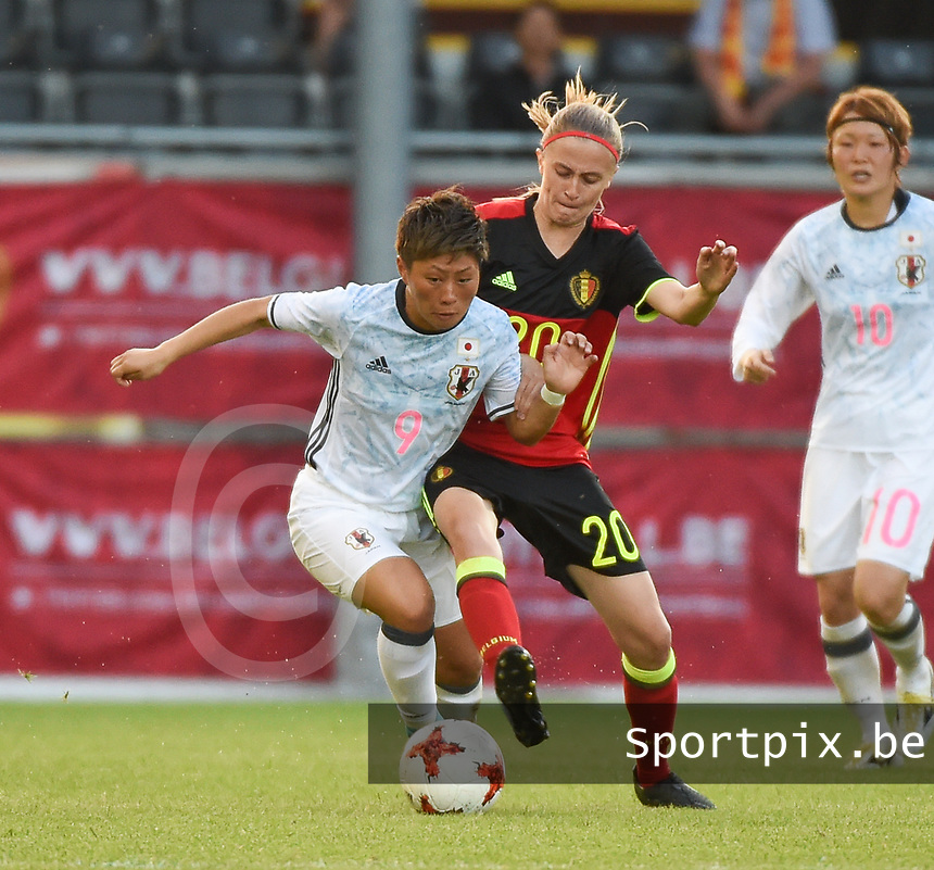 20170613 - LEUVEN ,  BELGIUM : Belgian Julie Biesmans (R) and Japanese Kumi Yokoyama (L) pictured during the female soccer game between the Belgian Red Flames and Japan , a friendly game before the European Championship in The Netherlands 2017  , Tuesday 13 th Juin 2017 at Stadion Den Dreef  in Leuven , Belgium. PHOTO SPORTPIX.BE | DIRK VUYLSTEKE