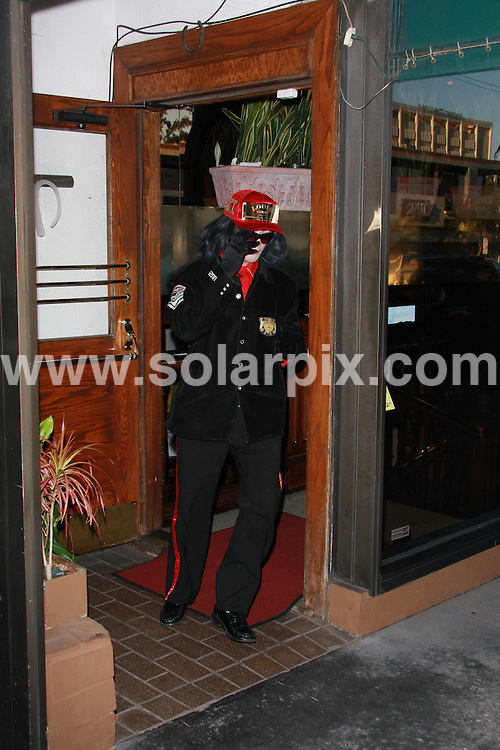 **EXCLUSIVE PICTURES FROM SOLARPIX.COM**.**WORLDWIDE SYNDICATION RIGHTS**.**NO PUBLICATION IN UK, USA, AUSTRALIA, NEW ZEALAND, DENMARK, GERMANY OR RUSSIA**.Michael Jackson was seen at Madeo Restaurant in Beverly Hills where he stayed for approximately 10 minutes.  He was in and out and is believed to have visited Madeo to use their restroom while out and about in Beverly Hills.  He was also seen inside the vehicle and decided to use his black vail to mask his face just seconds before his departure. 21st August 2008..This pic: Michael Jackson..JOB REF: 7080 LAP/SS/VIP Images       .DATE: 21_08_2008.**MUST CREDIT SOLARPIX.COM OR DOUBLE FEE WILL BE CHARGED* *UNDER NO CIRCUMSTANCES IS THIS IMAGE TO BE REPRODUCED FOR ANY ONLINE EDITION WITHOUT PRIOR PERMISSION*