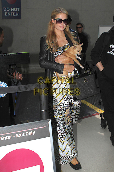 LOS ANGELES, CA - FEBRUARY 25: Paris Hilton seen arriving at LAX International Airport from New York City with her pet Chihuahua Peter Pan on February 25, 2014 in Los Angeles, California, USA.<br /> CAP/MPI/mpi99<br /> &copy;mpi99/MediaPunch/Capital Pictures
