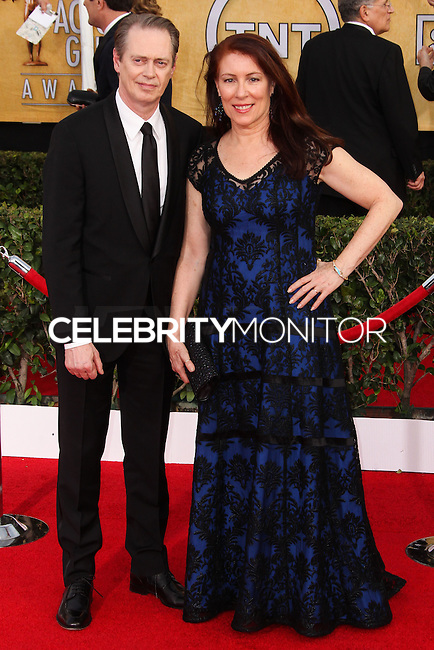 LOS ANGELES, CA - JANUARY 18: Steve Buscemi, Jo Andres at the 20th Annual Screen Actors Guild Awards held at The Shrine Auditorium on January 18, 2014 in Los Angeles, California. (Photo by Xavier Collin/Celebrity Monitor)