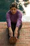 Hispanic woman doing stretch excercise