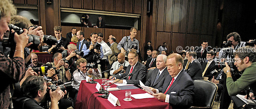 Washington, D.C. - December 5, 2006 -- Photographers surround the witness table prior to the United States Senate Armed Services Committee hearing on the nomination of Dr. Robert M. Gates to succeed Donald Rumsfeld as Secretary of Defense in Washington, D.C. on Tuesday, December 5, 2006.  From left to right:  former United States Senator Bob Dole (Republican of Kansas); Secretary of Defense-designate  Dr. Robert M. Gates, and former United States Senator David Boren (Democrat of Oklahoma).<br /> Credit: Cherie A. Thurlby - DoD via CNP