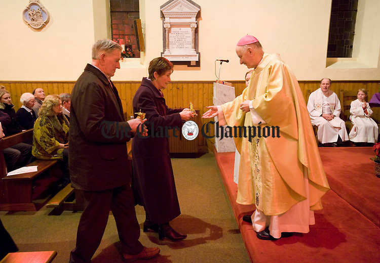 Bishop of Limerick Donal Murray accepting the gifts from Seamus and Joan Spaight  at the celebratory mass for the 150 year anniversary of the Little Church Sixmilebridge in Cratloe Parish. Photograph by John Kelly.