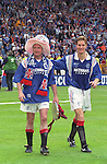 Paul Gascoigne and Richard Gough after the 1996 Scottish Cup Final at Hampden gazing at all the Rangers fans who have stayed behind for the lap of honour
