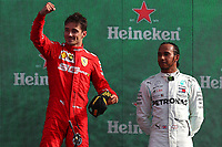Charles Leclerc of Scuderia Ferrari celebrates after winning as Lewis Hamilton of Mercedes, third, looks on <br /> Italian GP, Monza 5-8 September 2019<br /> Monza 08/09/2019 GP Italia <br /> Formula 1 Championship 2019 <br /> Photo Federico Basile / Insidefoto