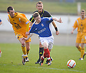 JAMES CREANEY PULLS BACK MARC MCKENZIE IN FRONT OF REFEREE MIKE TUMILTY
