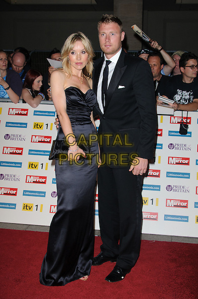 """Rachael Flintoff & Andrew """"Freddie"""" Flintoff.'The Daily Mirror's Pride Of Britain Awards 2011' at Grosvenor House Hotel, London, England..3rd October 2011.full length black strapless dress suit couple clutch bag.CAP/CJ.©Chris Joseph/Capital Pictures."""