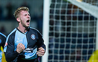 Jason McCarthy of Wycombe Wanderers celebrates scoring the winning goal making it 2-1 during the Sky Bet League 2 match between Wycombe Wanderers and Oxford United at Adams Park, High Wycombe, England on 19 December 2015. Photo by Andy Rowland.