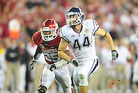 Jan. 1, 2011; Glendale, AZ, USA; Oklahoma Sooners linebacker (25) Corey Nelson runs alongside Connecticut Huskies tailback (44) Robbie Frey in the 2011 Fiesta Bowl at University of Phoenix Stadium. The Sooners defeated the Huskies 48-20. Mandatory Credit: Mark J. Rebilas-.