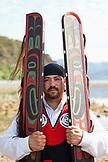 USA, Alaska, Sitka, Sheeta Kwan Naa Kahidi dancer in traditional costume, Nathan Howard by the Sitka Sound