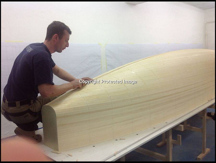 BNPS.co.uk (01202 558833)<br /> Pic: WFoil/BNPS<br /> <br /> ***Please use full byline***<br /> <br /> The boat being made.<br /> <br /> A high-speed powerboat inspired by First World War biplanes has become the world's first to 'fly' above the water on futuristic hydrofoils.<br /> <br /> The makers of the W-Foil Albatross claim it can hit blistering speeds of 70mph thanks to its revolutionary design which lifts the boat clear of the water.<br /> <br /> Rather than bring driven by an underwater propellor like other boats, it is pulled along by an aeroplane rotor.<br /> <br /> And because of its minimal drag, it is also among the most environmentally friendly powerboats in the world.
