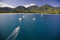 Cruising sailboats in beautiful Hanalei Bay