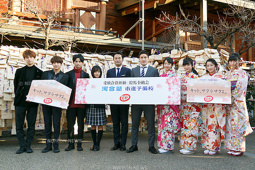 (L to R) Members of the boy band EBiSSH, actress Risaki Matsukaze, politician Taizo Sugimura, Olympic judo gold medalist Mashu Baker and members of Tokyo Girls' Style pose for cameras during a special Kit Kat event to encourage Japanese students for the next school entrance exams, at Yushima Tenjin Shrine on January 12, 2017, Tokyo, Japan. Nestle's Kit Kat product is popular with students because its pronunciation in Japanese sounds like ''Kitto Katsu'' which means ''surely win''. Every year Japanese students tie hand-written wishes and messages at the shrine, wishing for luck in passing entrance exams to high school and colleges. The Yushima Tenjin Shrine is dedicated to the god of learning. (Photo by Rodrigo Reyes Marin/AFLO)