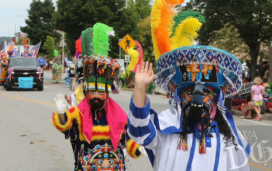 NWA Democrat-Gazette/DAVID GOTTSCHALK  Dancers with Chinelos Morelenses Unidos en Arkansas make their way along Emma Avenue June 21, 2017, as they participate in the annual Rodeo of the Ozarks Parade in Springdale. The parade kicks off the 73rd annual rodeo that opened Wednesday evening and runs through Saturday at Parsons Stadium.