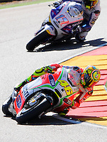 Valentino Rosii and Karel Abraham Taking a corkscrew during the Grand Prix Aragon 2012