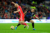 Jonny Williams of Wales is tackled by Luka Modrićof Croatia during the UEFA Euro 2020 Qualifier between Wales and Croatia at the Cardiff City Stadium in Cardiff, Wales, UK. Sunday 13 October 2019