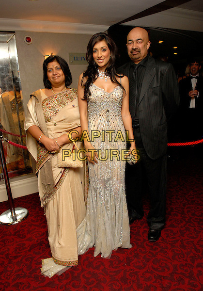 PREETI DESAI, FORMER MISS GREAT BRITAIN 2006 & her parents.At the Miss Great Britain 2007 Grand Final,.Grosvenor House Hotel, Park Lane, London, England, .May 21st 2007..full length silver gold beaded dress Indian style sari mother father.CAP/FIN.©Steve Finn/Capital Pictures.