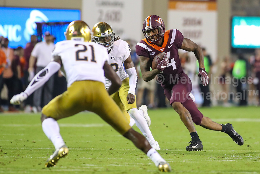 Blacksburg, VA - October 6, 2018: Virginia Tech Hokies wide receiver Damon Hazelton (14) tries to avoid Notre Dame Fighting Irish safety Jalen Elliott (21) during the game between Notre Dame and VA Tech at  Lane Stadium in Blacksburg, VA.   (Photo by Elliott Brown/Media Images International)
