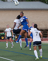 Sky Blue FC forward Danesha Adams (9) and Boston Breakers defender Kia McNeill (14) leap to head a high ball off a corner kick.  In a National Women's Soccer League Elite (NWSL) match, Sky Blue FC defeated the Boston Breakers, 3-2, at Dilboy Stadium on June 16, 2013
