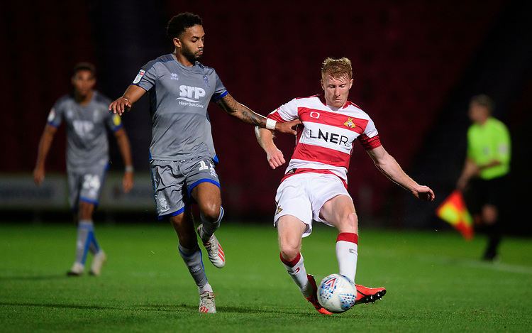 Doncaster Rovers' Brad Halliday under pressure from Lincoln City's Bruno Andrade<br /> <br /> Photographer Chris Vaughan/CameraSport<br /> <br /> EFL Leasing.com Trophy - Northern Section - Group H - Doncaster Rovers v Lincoln City - Tuesday 3rd September 2019 - Keepmoat Stadium - Doncaster<br />  <br /> World Copyright © 2018 CameraSport. All rights reserved. 43 Linden Ave. Countesthorpe. Leicester. England. LE8 5PG - Tel: +44 (0) 116 277 4147 - admin@camerasport.com - www.camerasport.com