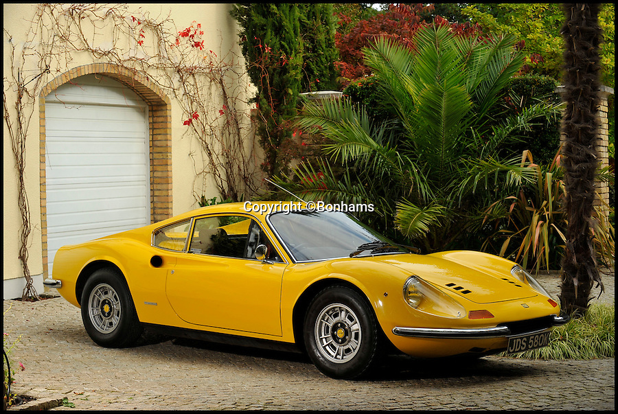 BNPS.co.uk (01202 558833)<br /> Pic: Bonhams/BNPS<br /> <br /> ***Please Use Full Byline***<br /> <br /> AA flash Ferrari sports car bought by Elton John when he first found fame which he then gave to his drummer as a present has emerged for sale for almost &pound;300,000.<br /> <br /> The flamboyant rocker snapped up the bright yellow Ferrari Dino 206GT in November 1972, the same month hit single Crocodile Rock rocketed up the charts.<br /> <br /> Sir Elton drove the plush motor for six months, racking up 5,000 miles in the process, before gifting it to his longstanding drummer Nigel Olsson in June 1973.<br /> <br /> Experts at London auction house Bonhams expect it to fetch &pound;280,000 when it goes under the hammer at Bonhams in London.