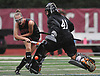 Mary Sotiryadis #41, North Shore goalie, comes out of the crease to force Jessica de la Bastide #26 of Friends Academy to shoot wide during a rain-filled Nassau County League 3 varsity field hockey game at North Shore High School in Glen Head on Thursday, Oct. 11, 2018. North Shore won by a score of 3-1.