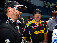 Jun. 1, 2014; Englishtown, NJ, USA; NHRA funny car driver Del Worsham (right) with top due driver Shawn Langdon during the Summernationals at Raceway Park. Mandatory Credit: Mark J. Rebilas-