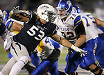 Nevada's Brock Hekking drives past San Jose State's Wes Schweitzer in an NCAA college football game in Reno, Nev., on Saturday, Nov. 16, 2013. (AP Photo/Cathleen Allison)