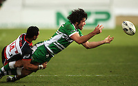 Manawatu flanker Nick Crosswell passes in the tackle of Lelia Masaga during the Air NZ Cup rugby match between Manawatu Turbos and Counties-Manukau Steelers at FMG Stadium, Palmerston North, New Zealand on Sunday, 2 August 2009. Photo: Dave Lintott / lintottphoto.co.nz