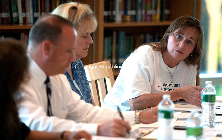 OXFORD, CT 30 JUNE, 2010-063010JS04-Oxford School  Board of Education member Paula Guillet, right, talks with other board members as they discuss the employment of Superintendent Dr. Judith A. Palmer during a meeting Wednesday at Oxford High School. The board decided to extend her employment until July 31.<br /> Jim Shannon Republican-American