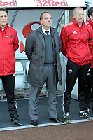 Pictured: Brendan Rodgers manager for Swansea observes a minute's silence  before kick off in memory of Wales football manager Gary Speed who has died. Saturday 27 November 2011<br /> Re: Premier League football Swansea City FC v Aston Villa at the Liberty Stadium, south Wales.