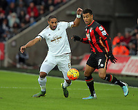 Joshua King of Bournemouth (C) is challenged by Ashley Williams of Swansea (L) during the Barclays Premier League match between Swansea City and Bournemouth at the Liberty Stadium, Swansea on November 21 2015