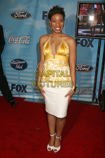 "STEPHANIE EDWARDS.""American Idol"" Season 6 Top 12 Finalists Party at Astra West/Pacific Design Center, West Hollywood, California, USA, 8 March 2007..full length yellow halterneck satin top white skirt.CAP/ADM/BP.©Byron Purvis/AdMedia/Capital Pictures."