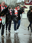 Southampton fans make there way to the stadium in the bad weather - Barclays Premier League - Southampton vs Liverpool - St Mary's Stadium - Southampton - England - 22nd February 2015 - Pic Robin Parker/Sportimage