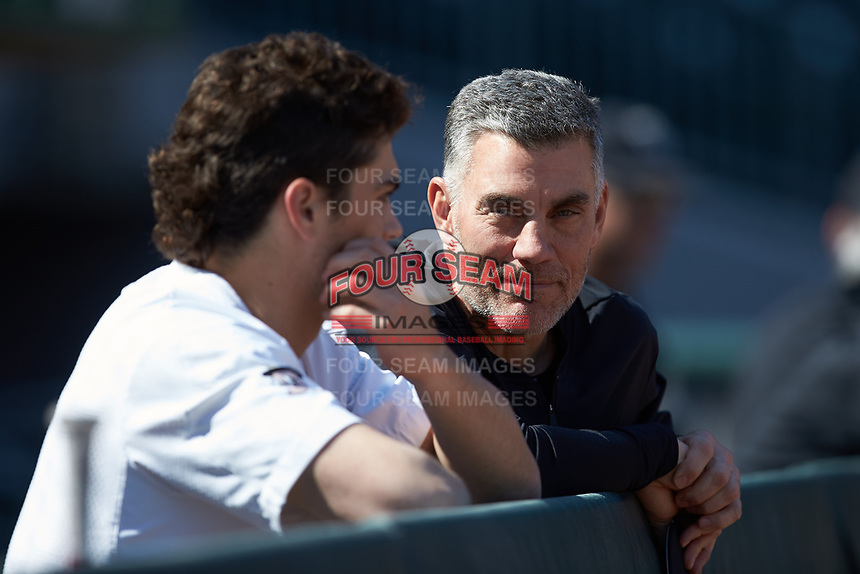 Wake Forest Demon Deacons head coach Tom Walter (right) chats with freshman outfielder Hite Merrifield prior to the game against the Furman Paladins at BB&T BallPark on March 2, 2019 in Charlotte, North Carolina. The Demon Deacons defeated the Paladins 13-7. (Brian Westerholt/Four Seam Images)