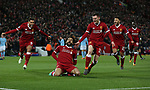 Mohamed Salah of Liverpool slides to celebrate scoring the first goal during the Champions League Quarter Final 1st Leg, match at Anfield Stadium, Liverpool. Picture date: 4th April 2018. Picture credit should read: Simon Bellis/Sportimage