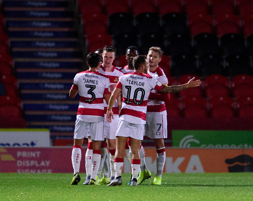 Doncaster Rovers' Cameron John celebrates scoring his side's equalising goal to make the score 1-1 with team-mates<br /> <br /> Photographer Andrew Vaughan/CameraSport<br /> <br /> EFL Leasing.com Trophy - Northern Section - Group H - Doncaster Rovers v Lincoln City - Tuesday 3rd September 2019 - Keepmoat Stadium - Doncaster<br />  <br /> World Copyright © 2018 CameraSport. All rights reserved. 43 Linden Ave. Countesthorpe. Leicester. England. LE8 5PG - Tel: +44 (0) 116 277 4147 - admin@camerasport.com - www.camerasport.com