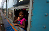HAVANA, CUBA - APRIL 5:  A girl looks out the window at the Ciego de Avila train station, during the trip from La Havana to Santiago de Cuba on April 5, 2018.. in Cuba. Ferrocarriles de Cuba, is one of the oldest railroad around world, having opened its first route in 1837 with at least 17-mile long. Now the railway probably could cover more than 2,600 miles along the Island. (Photo by Eliana Aponte/VIEWpress)