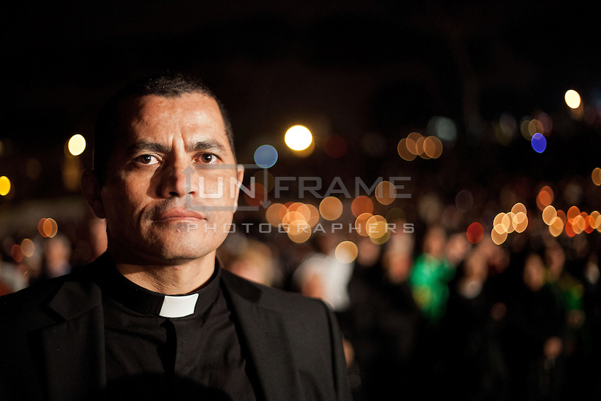 A priest seen during an evening vigil ahead of the beatification of Pope John Paul ll.