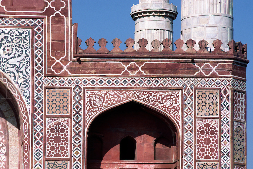 Detail of the ISLAMIC PATTERNS and red sandstone of AKBAR'S MAUSOLEUM (tomb), completed in 1613 - AGRA, INDIA.
