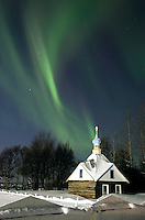 The northern lights or aurora borealis fill the western sky March 9, 2012, above the Russian Orthodox Saint Nicholas Memorial Chapel in Kenai, Alaska.