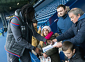 2nd December 2017, The Hawthorns, West Bromwich, England; EPL Premier League football, West Bromwich Albion versus Crystal Palace; Pape Souare of Crystal Palace signing autographs on pitch side before the match