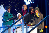 United States President Barack Obama, accompanied by First Lady Michelle Obama, their daughters Malia, right, and Sasha, left, and Marian Robinson, Michelle Obama's mother, light the National Christmas Tree at a ceremony on the Ellipse near the White House in Washington, DC, on Thursday, December 9, 2010. The first Christmas tree lighting ceremony took place back in 1923, with U.S. President Calvin Coolidge presiding. .Credit: Andrew Harrer / Pool via CNP