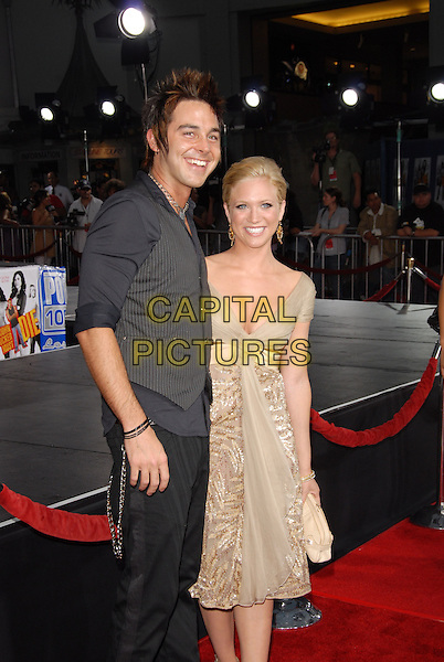 "BRITTANY SNOW & GUEST.Los Angeles Premiere of ""John Tucker Must Die"" held at The Grauman's Chinese Theatre in Hollywood, California  .July 25th, 2006.Ref: DVS.half length beige dress clutch purse  pinstripe grey gray vest couple.www.capitalpictures.com.sales@capitalpictures.com.©Debbie VanStory/Capital Pictures"