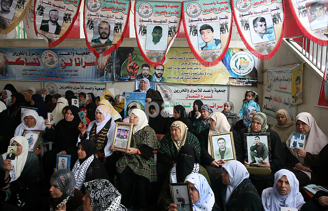 Palestinian women hold pictures of jailed relatives during a protest calling for the release of Palestinian prisoners from Israeli jails at the Red Cross office in Gaza City on Feb 8,2010. Photo by Mohammed Othman