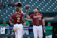 Jackson Lueck (2) of the Florida State Seminoles celebrates a home run with Quincy Nieporte against the Notre Dame Fighting Irish in Game Four of the 2017 ACC Baseball Championship at Louisville Slugger Field on May 24, 2017 in Louisville, Kentucky. The Seminoles walked-off the Fighting Irish 5-3 in 12 innings. (Brian Westerholt/Four Seam Images)