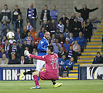 Ross Laidlaw saves Kris Boyd's shot although one fan in the crowd thinks it is a cert to go in