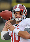 Alabama Crimson Tide quarterback AJ McCarron (10) warms up before the game. The Alabama Crimson Tide defeated the Missouri Tigers 42-10 at Memorial Stadium in Columbia, Missouri on October 13, 2012.